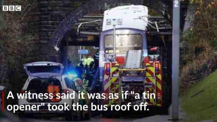 Double decker bus hits low bridge